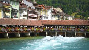 Bridge with a water gate in Thun town in Switzerland stock video footage