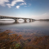 Bridge and water with long exposure. Running clouds stock photos