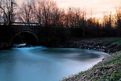 Bridge. And water at sunset Royalty Free Stock Image