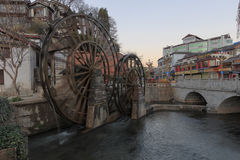 Bridge and Water wheels at the entrance on Lijiang Old Town in Yunnan Stock Images