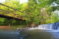Bridge And Waterfall. An old unused bridge and where a mill used to stand. Now only nature remains in its serene beauty Stock Photography