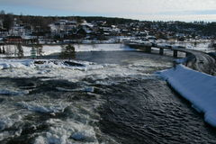 Bridge and waterfall. A waterfall and a bridge in a winter day. Kongsberg, Norway Royalty Free Stock Photography