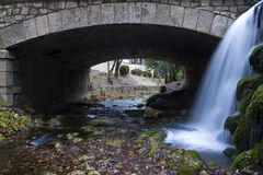 Bridge with waterfall. Little bridge made of stones in Cuenca, Spain, with a beautiful waterfall at is side stock photography