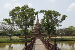Bridge way to Big stone Stupa at Archaeological Park Buddhist temples of Sukhothai, Thailand Stock Images