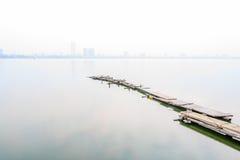 Bridge in west lake in fog, Hanoi, Vietnam Stock Photography