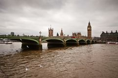 Bridge and Westminster house of parliment in london stock photos