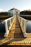 The bridge with a white handrail to a palace. The bridge with a white handrail and brick floor to a palace Marli, Peterhof, St. Petersburg, Russia Stock Photos