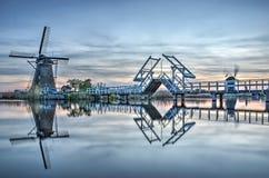 Bridge and windmill at dusk Stock Image