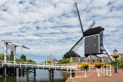 Bridge and windmill in Netherlands Royalty Free Stock Image