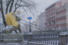 Bridge with winged lions. Winter, statues of the lions, Russia, Saint Petersburg Stock Photos