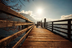 Bridge in winter in Austria with a view of the mountains and the lake royalty free stock photo