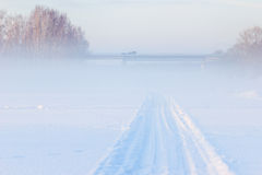 Bridge and Winter fog over the frozen river. A sudden fog on a cold day Royalty Free Stock Photography