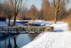 Bridge in winter landscape Stock Photos