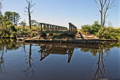 A Bridge Withdrawn. A draw bridge on the Dismal Swamp portion of the Intercostal Waterway.This is the oldest continually operating man-made canal in the United Royalty Free Stock Images
