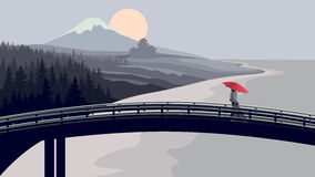 Bridge, woman with red umbrella, mountains. Royalty Free Stock Image