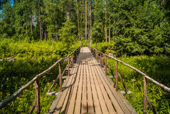 Bridge. Wooden bridge over the river Royalty Free Stock Images