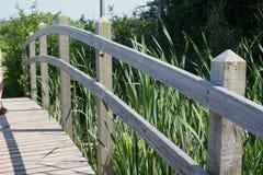 Bridge Wooden Railing. A wooden railing on a decorative bridge stock image