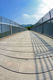 Bridge with a wooden walkway and handrail made of galvanize Stock Photography