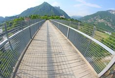 Bridge with a wooden walkway and handrail made of galvanize Stock Photos