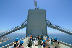 Bridge World Tour. Participants look over the edge from 300m above sea level atop a suspension bridge tower. The tour covers the Akashi Kaikyo Bridge in Kobe Royalty Free Stock Photography