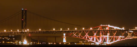 The Bridges. The Forth road and rail bridges at night taken from the west end of South Queensferry, Edinburgh, Scotland Royalty Free Stock Photo