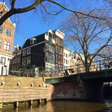 Bridges in Amsterdam. Beautiful houseboats in Amsterdam Royalty Free Stock Photography