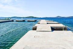 The beach bridges. The bridges on the background of island Prvic, Vodice, Croatia stock photo