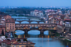 Bridges of Florence. Looking down on the many beautiful bridges of Florence, Italy as night falls on the historic city Stock Photos