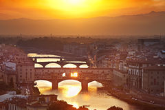 Bridges of Florence at sunset, Italy. Bridges of Florence over the Arno River at sunset, Italy royalty free stock photography
