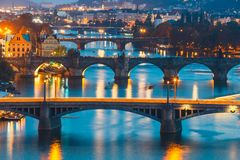 Bridges with historic Charles Bridge and Vltava river at night in Prague. View of  bridges with historic Charles Bridge and Vltava river at night in Prague Royalty Free Stock Photography