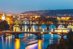 Bridges with historic Charles Bridge and Vltava river at night in Prague. View of  bridges with historic Charles Bridge and Vltava river at night in Prague Royalty Free Stock Photos