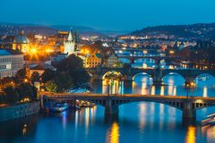 Bridges with historic Charles Bridge and Vltava river at night in Prague. View of bridges with historic Charles Bridge and Vltava river at night in Prague, Czech stock photos