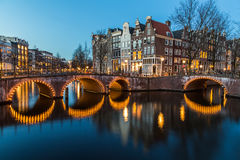 Bridges at the Leidsegracht and Keizersgracht canals intersectio Royalty Free Stock Photo