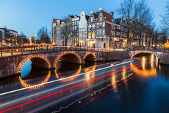 Bridges at the Leidsegracht and Keizersgracht canals intersectio. A view of the bridges at the Leidsegracht and Keizersgracht canals intersection in Amsterdam at Royalty Free Stock Images