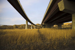 Bridges. In Lethbridge Alberta. One of the  is a pedestrian and cycling bridge and the other a road bridge carrying Whoop Up Drive across the Old Man River Royalty Free Stock Photography