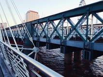 Bridges metal steels symbol blue sky water. Travel river city centre art symbol london Royalty Free Stock Images