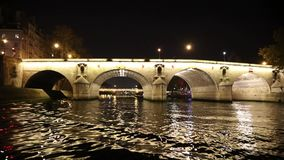 Bridges from movement boat at night in Paris stock video footage