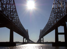 Bridges Of New Orleans. The view of New Orleans bridges with the Sun shining in a middle (Louisiana Royalty Free Stock Photography