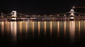 Bridges at night, Budapest, Hungary. Long exposure shot of the bridges in Budapest. The shot was taken at night, with all the lights reflected on the Danube`s Stock Images