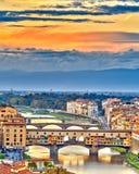 Bridges over Arno river in Florence. Bridges over Arno river at sunset, Florence, Italy Royalty Free Stock Images