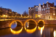 Bridges over canals in Amsterdam at night Stock Photo