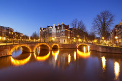 Bridges over canals in Amsterdam at night Royalty Free Stock Photos