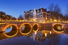 Bridges over canals in Amsterdam at night Royalty Free Stock Photo