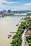 Bridges over the Danube river in Bratislava, Slovakia. Bridges over the Danube river in Bratislava city, Slovak republic. Docks scene. Old bridge and Apollo Royalty Free Stock Photography