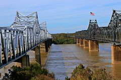 Bridges over the Mississippi River at Vicksburg. Vicksburg Bridge is a cantilever bridge carrying Interstate 20 and U.S. Route 80 across the Mississippi River stock images