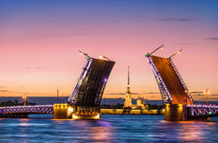 Bridges are separated in St. Petersbur. Separated Palace Bridge in St Petersburg and Peter and Paul Fortress Stock Image