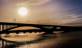 Bridges In Silhouette Over The River Stock Images