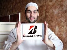 Bridgestone tyre manufacturer logo. Logo of bridgestone tyre manufacturer on samsung  tablet holded by arab muslim man. Bridgestone Corporation is a Stock Images
