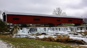 Bridgeton Covered Bridge. This is a Winter picture of the iconic Bridgeton Covered Bridge over the mostly frozen Big Raccoon Creek And Waterfall located in royalty free stock image