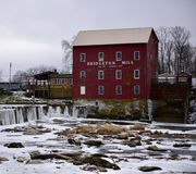 Bridgeton Mill. This is a Winter picture of the Bridgeton Grist Mill on the near frozen Big Raccoon Creek And Waterfall located in Bridgeton, Indiana in Parke Stock Image